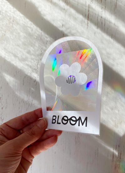 light shining on bloom suncatcher window decal