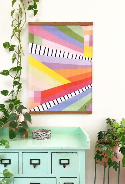 colourful tea towel hanging on wall